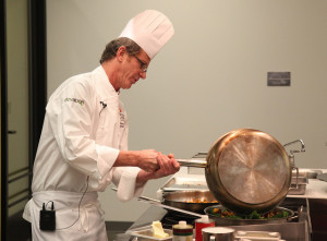 Chef Julian Darwin preparing food at the Cascade Culinary Institute.